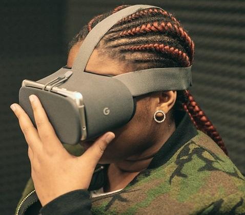 A black student wearing a virtual reality headset