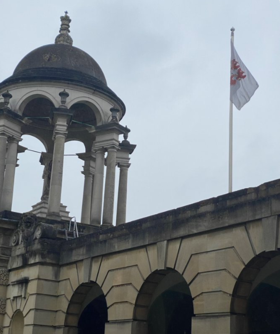 The Queen's College's flag flying above its entrance