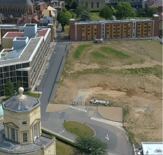 An aerial view of a parcel of empty land within the Radcliffe Observatory quarter in Oxford