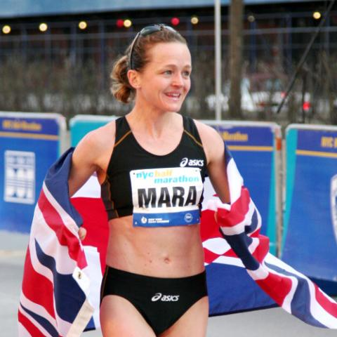 Mara Yamauchi after the finish of the New York Half Marathon, with the Union flag across her shoulders