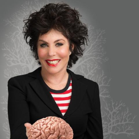 Ruby Wax holding a model of a brain