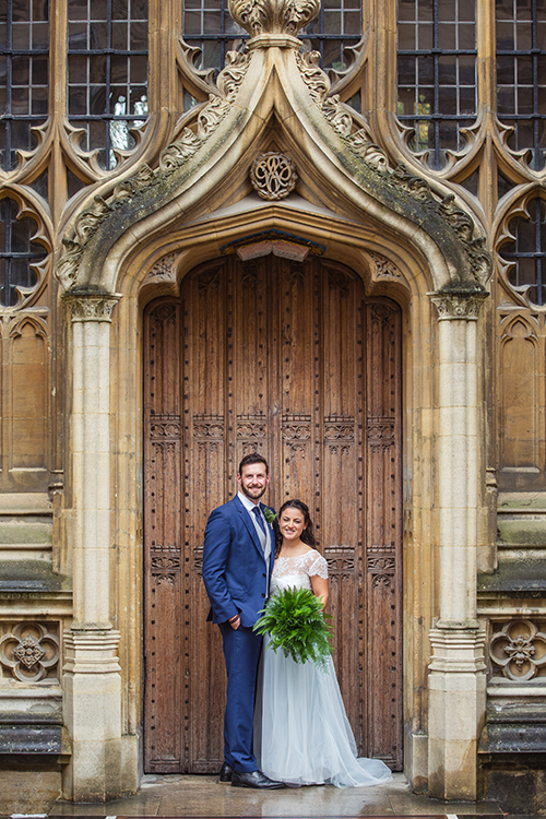 Alex Woods and Zoe de Toledo, on their wedding day, in an ornate doorway to the Bodleian Library