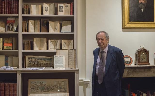 Sir Geoffrey Bindman, stood next to an exhibition of some of his books and prints