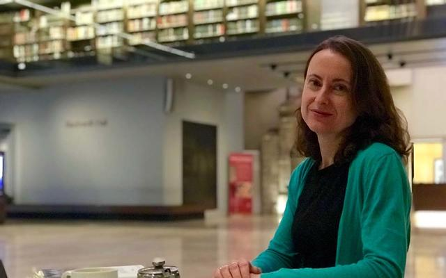 Emily Wilson sat in the cafe of the Weston Library