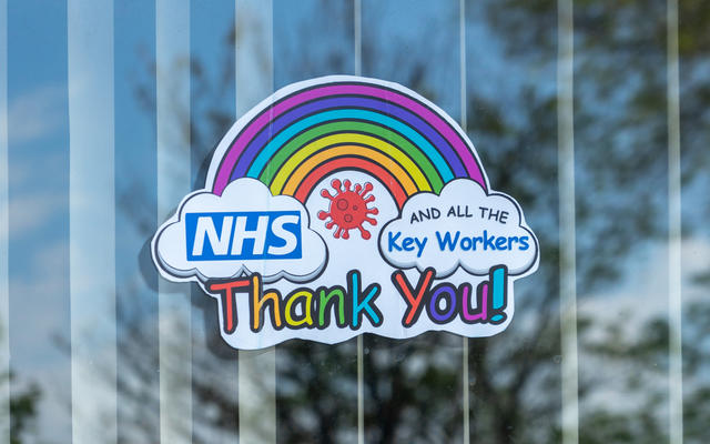 A sticker in a window, with a rainbow and a message saying 'thank you NHS and all the key workers'