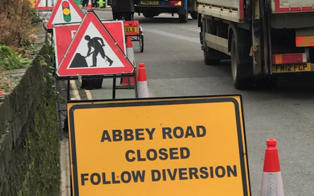 Road works and a sign saying 'Abbey Road closed, follow diversion'