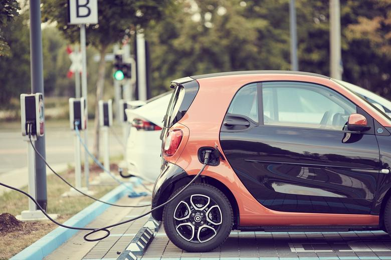 Electric car plugged into charge point