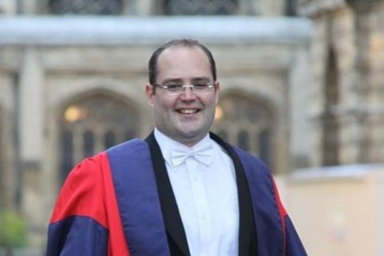 Tarek Cheniti in graduation gowns