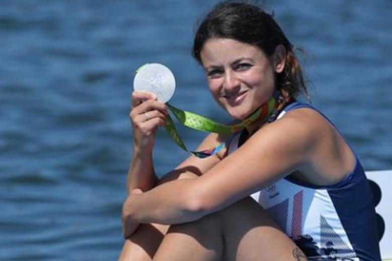 Zoe de Toledo sat next to the boating lake at the 2016 Olympics, holding up her silver medal