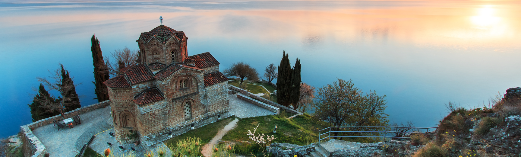 Sveti Jovan Kaneo Church in the foreground on the shore of Lake Ohrid