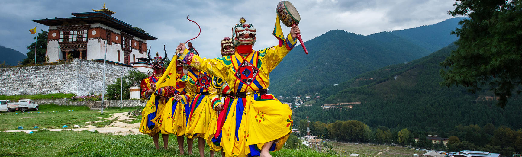 Costumed monks performing traditional dance in Tsechu festival at Thimphu Bhutan
