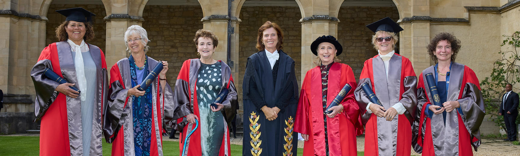 Six honorary degree recipients stand with the Vice-Chancellor at Encaenia, 2021