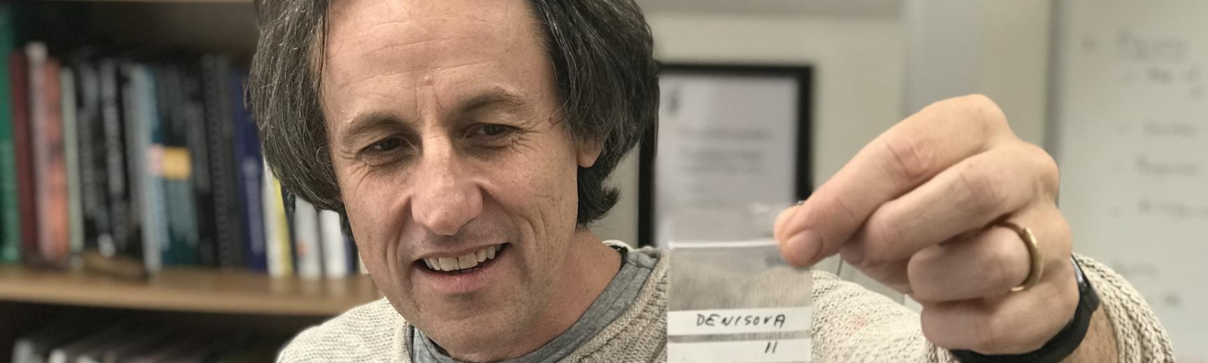 Professor Tom Higham presenting a sample to camera