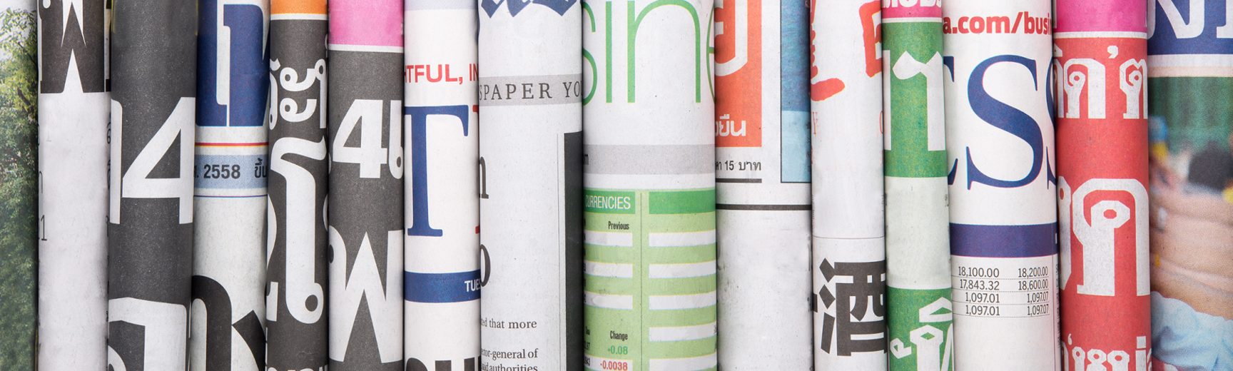 Newspaper article stack