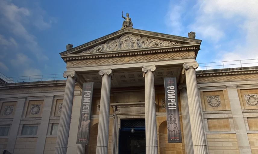 The exterior of the Ashmolean Museum, looking up from ground level on Beaumont Street