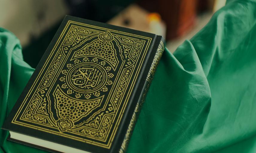 Quran on green fabric