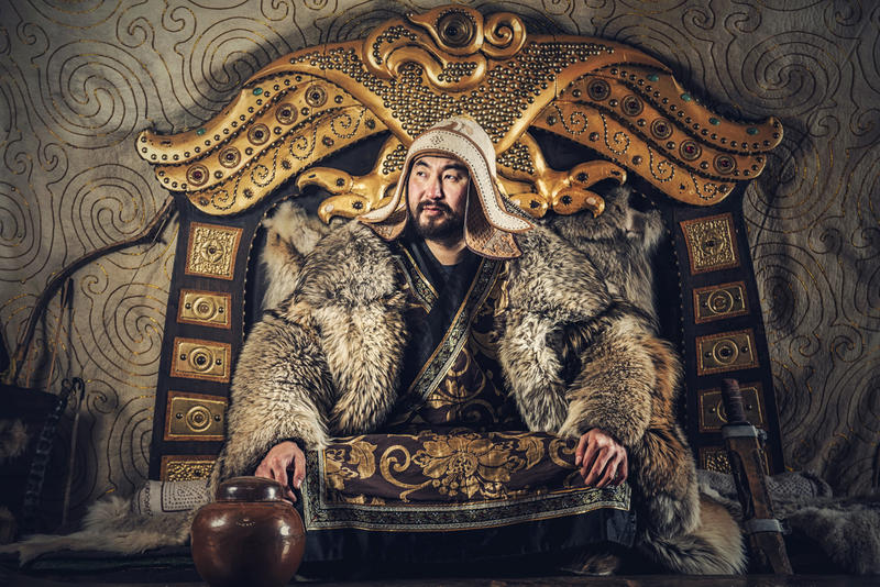 A recreation of Genghis Khan, sat on a throne