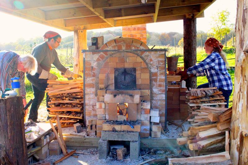 Volunteers working around the anagama kiln