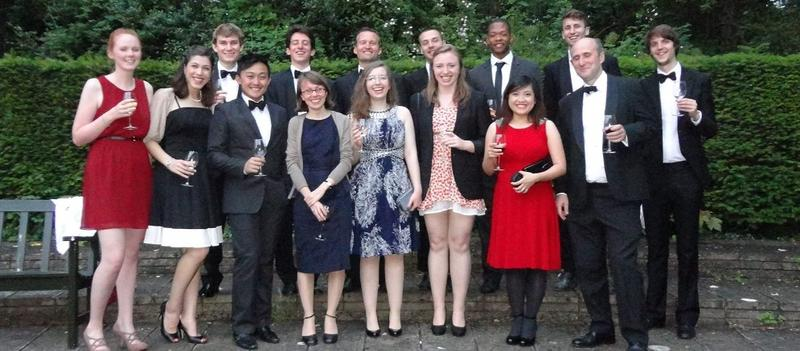 A group of students posing for a photo at a college ball