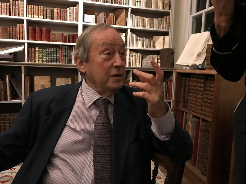 Sir Geoffrey Bindman, seated, in conversation
