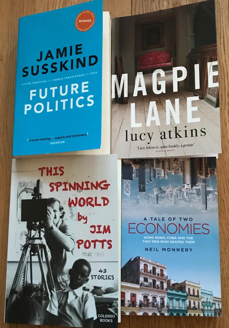 Four books on a table - 'Future Politics' by Jamie Susskind; Magpie Lane by Lucy Atkins; The Spinning World by Jim Potts; A tale of two economies by Neil Monnery