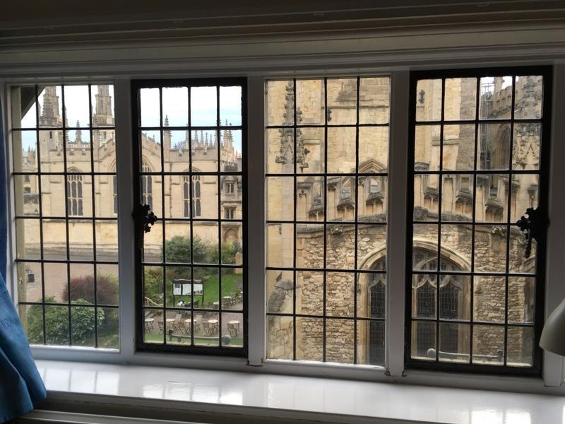 The view from a window of Brasenose College, with University Church of St Mary the Virgin in the foreground and All Souls College in the background