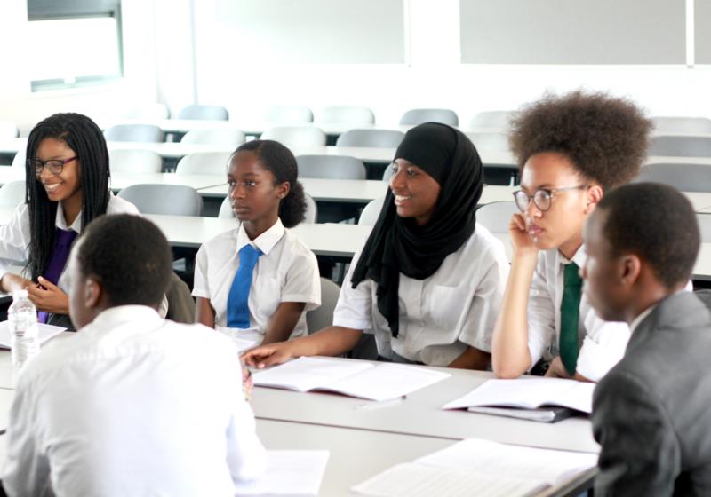 School children from minority ethnic groups, sat in a classroom