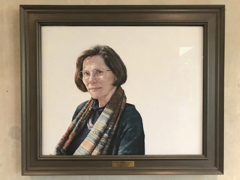 A portrait of Professor Dame Hermione Lee in a brown frame