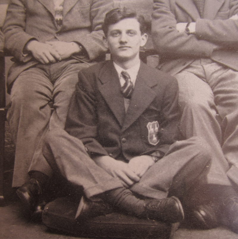 Sir John Houghton seated on the floor in a photograph of the Jesus College rowing squad