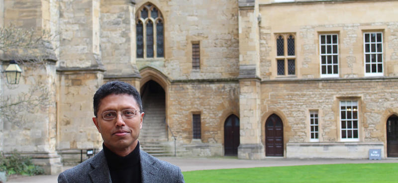 Masud Husain stood in a quad of an Oxford college