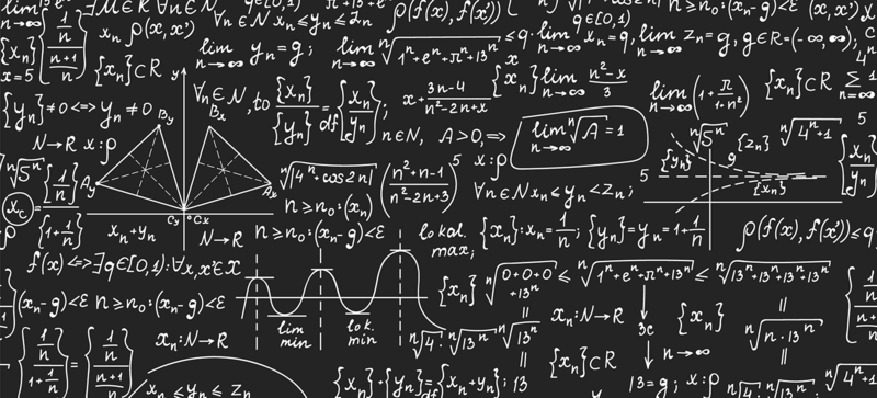 A blackboard covered with numerous mathematical equations