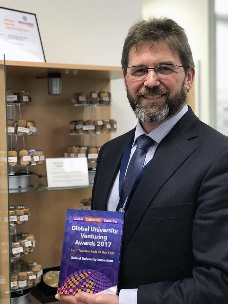 Matt Perkins holding OUI's Tech Transfer Unit of the Year 2017 Award
