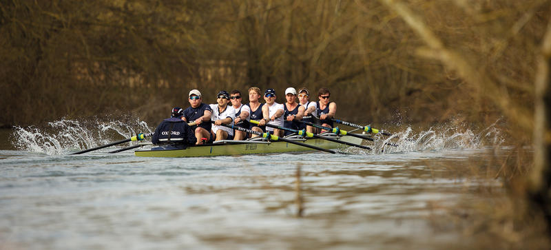 Oxford University rowing team training on the river