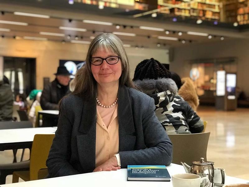 Paula Boddington sat at a cafe table in the Weston Library