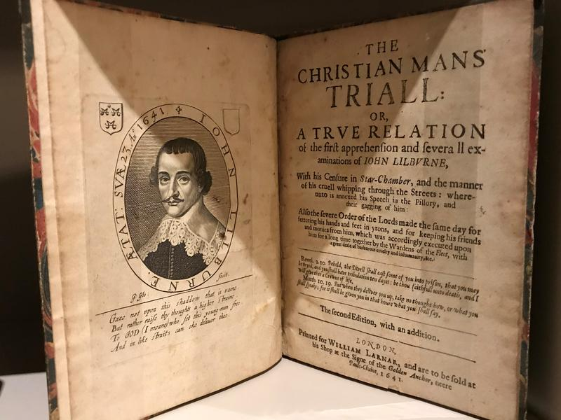 An old, open book, showing a page titled 'The Christian Mans' Triall' (sic)