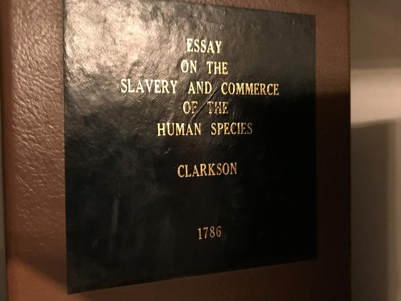 The cover of an old book, 'Essay on the slavery and commerce of the human species' by Clarkson from 1786