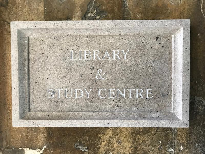 A stone plate saying 'Library & Study Centre'