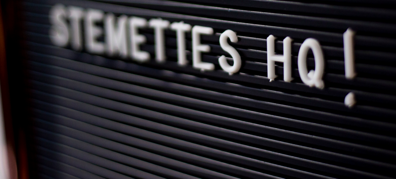 A pushboard with letters spelling out 'STEMETTES HQ!'
