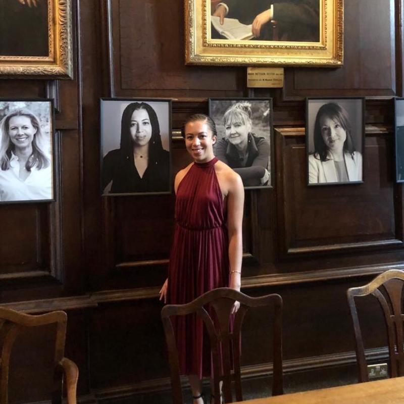 Naomi Kellman in the hall of Lincoln College