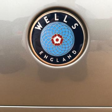 Wells Vertige logo